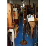 Turned wood standard lamp.