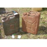 Two military Jerry cans, dated 1944 and 1951.