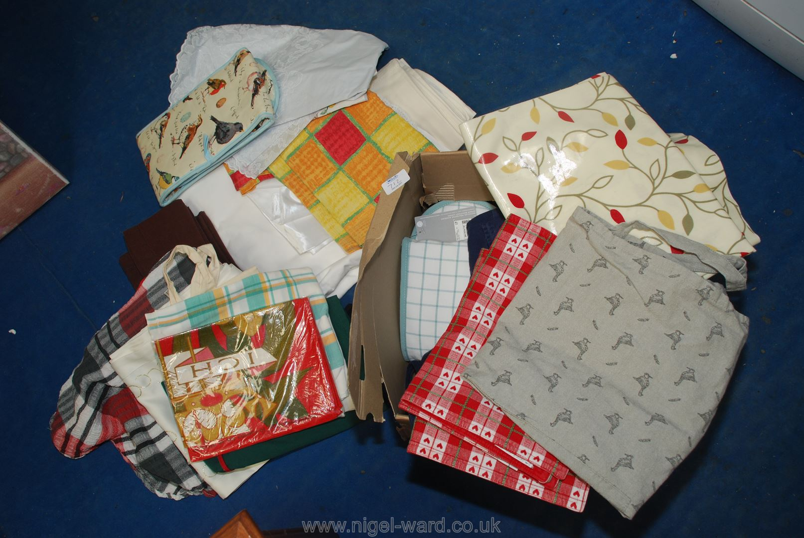 Box of various table cloths etc