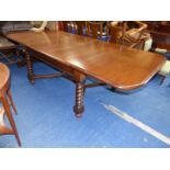 A heavy mid-Oak pull-out Dining Table, 42 1/4'' x 50'' extending with three leaves to 88 1/4'',