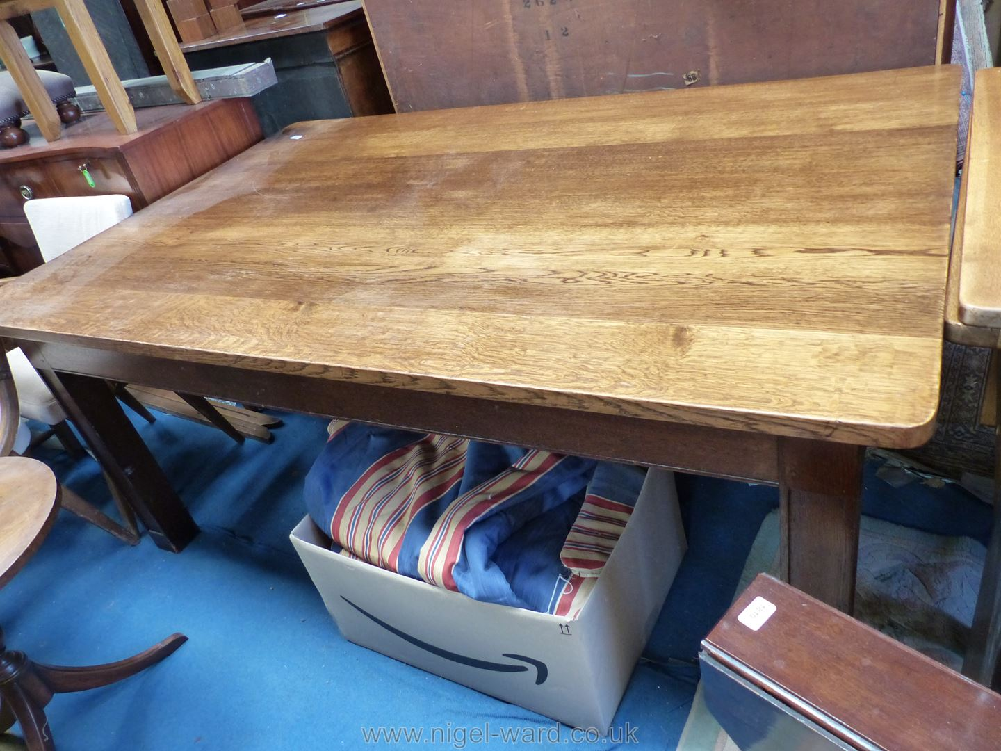 A heavy Oak boardroom/Dining Table of peg joined construction and standing on four heavy square