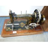 A Frister & Rossmann Hand Sewing Machine in wooden case.