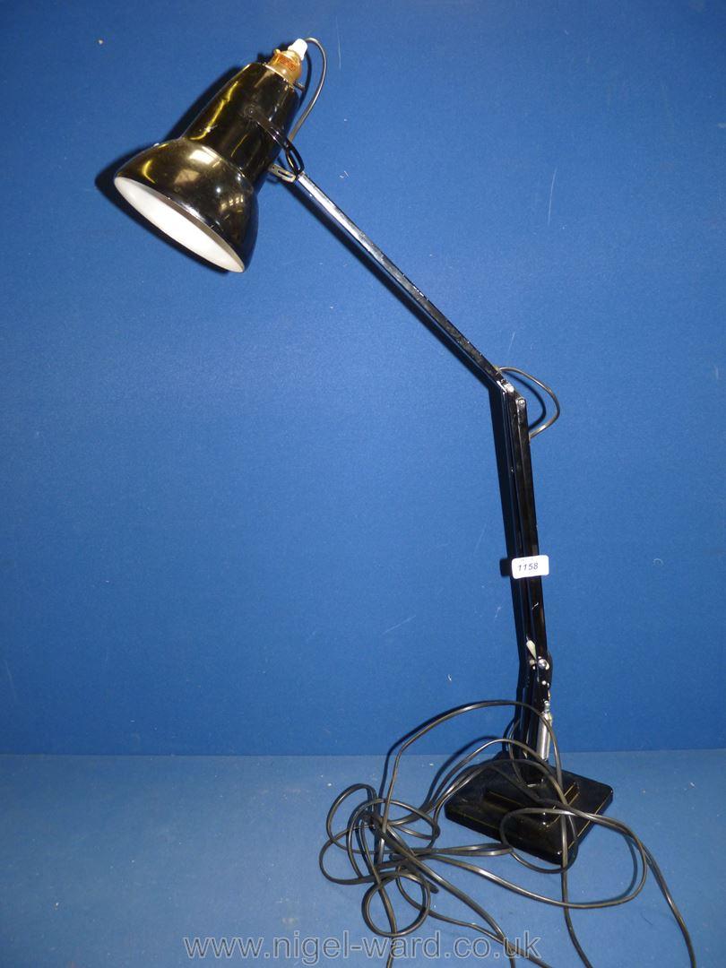 A black angle poise lamp.