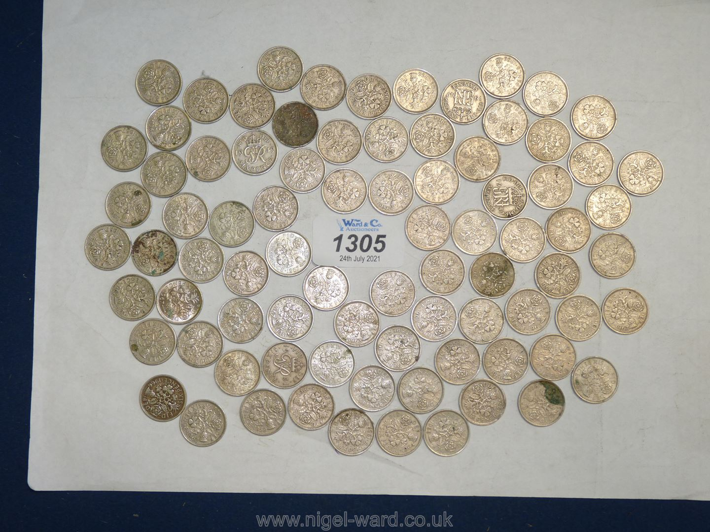 82 old sixpence pieces.