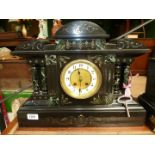 A Victorian marble detailed polished slate mantle clock with key and brass bob-weight pendulum,