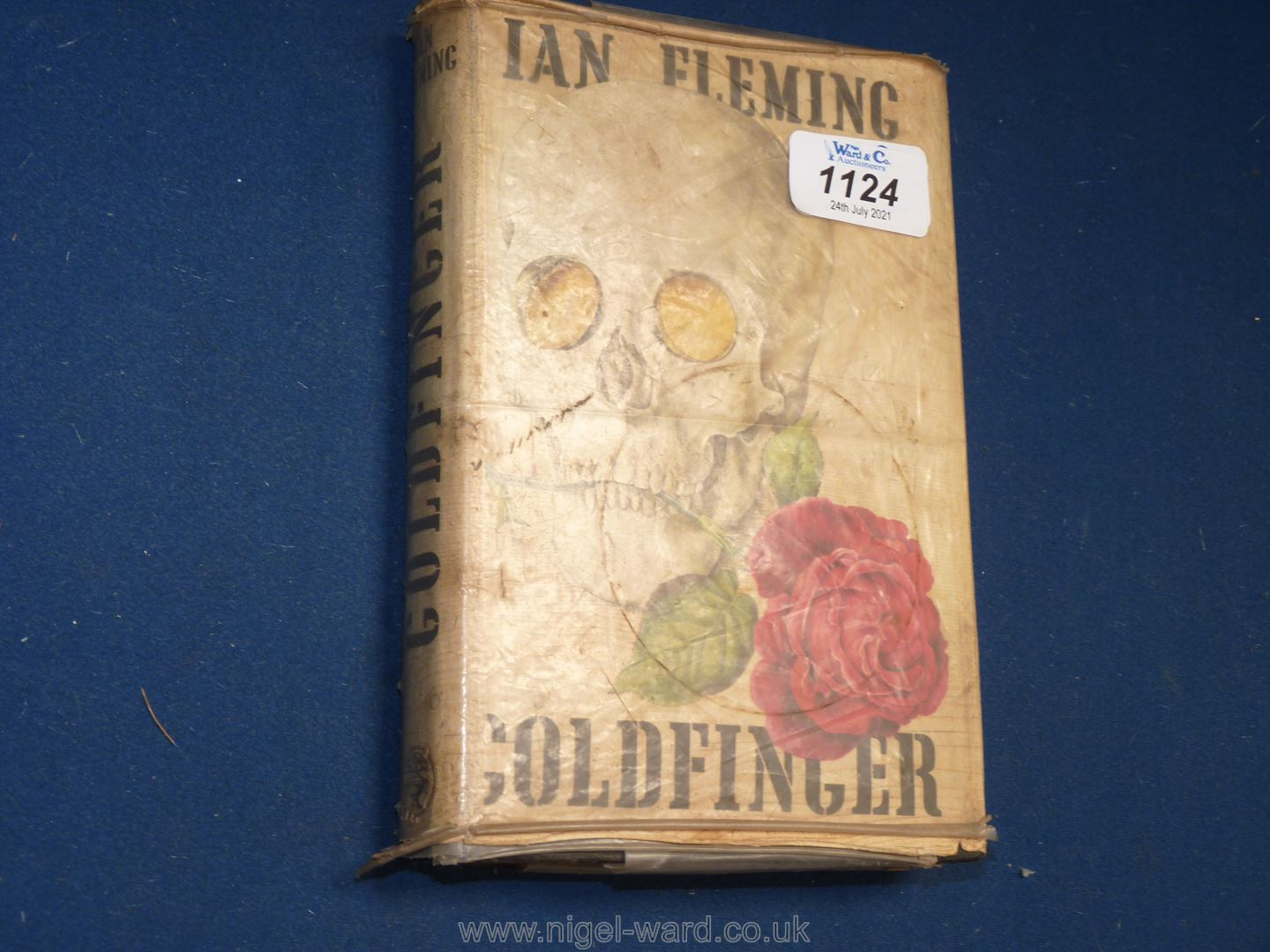 A first edition of 'Goldfinger' by Ian Fleming, Library edition, dust cover worn, loose binding.
