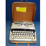 A Brother portable typewriter in brown case.