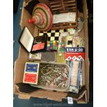 A quantity of games including chess Set with metal pieces, brass cribbage board, playing cards, etc.
