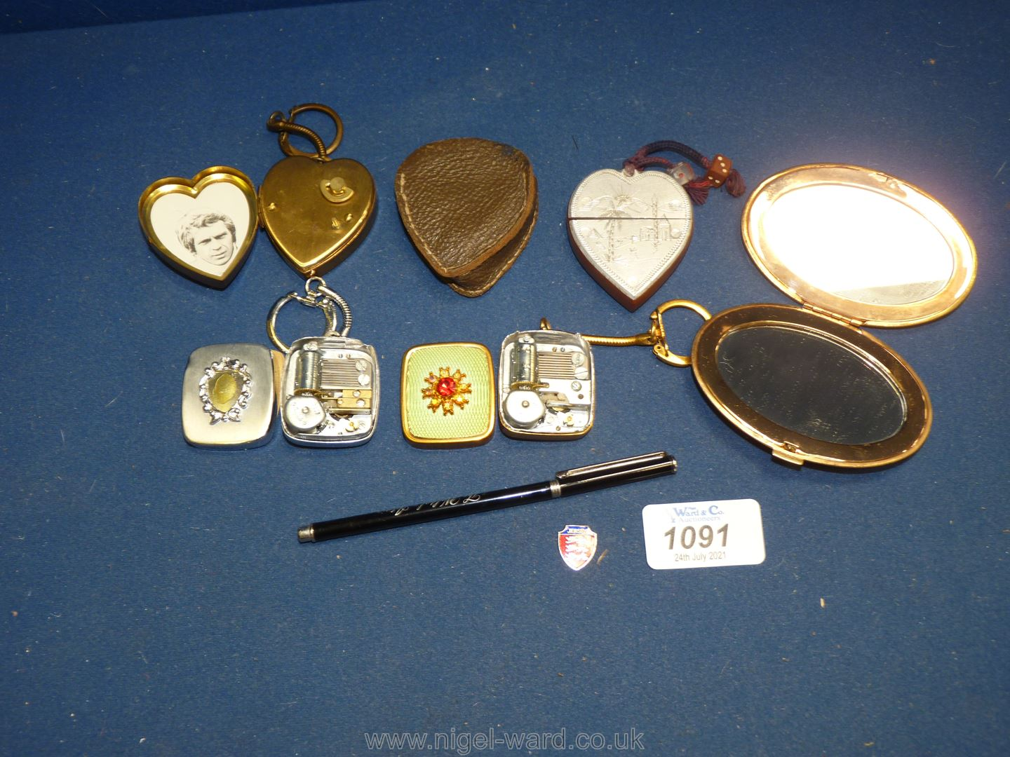 A quantity of vintage musical box key rings, novelty lighter etc.