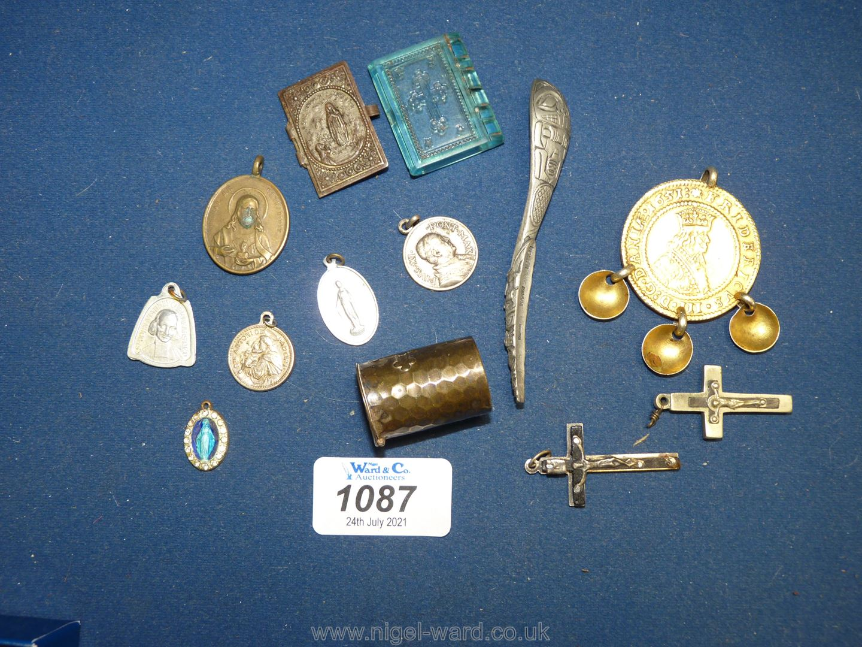 A quantity of religious medallions, Crucifix etc.