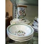 A quantity of Portmeirion Botanic Garden dinner plates, side plates and a storage jar.