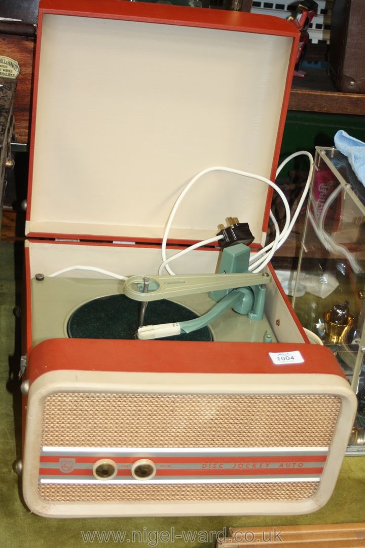 A Phillips 1960's record player in terracotta coloured case.