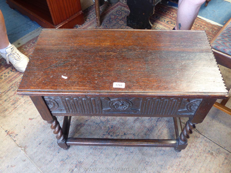 A dark Oak locker top Table/sewing box having twist legs joined by perimeter stretchers and having