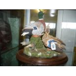 A Country Artists figurine of two colourful ducks 'Restful days'.