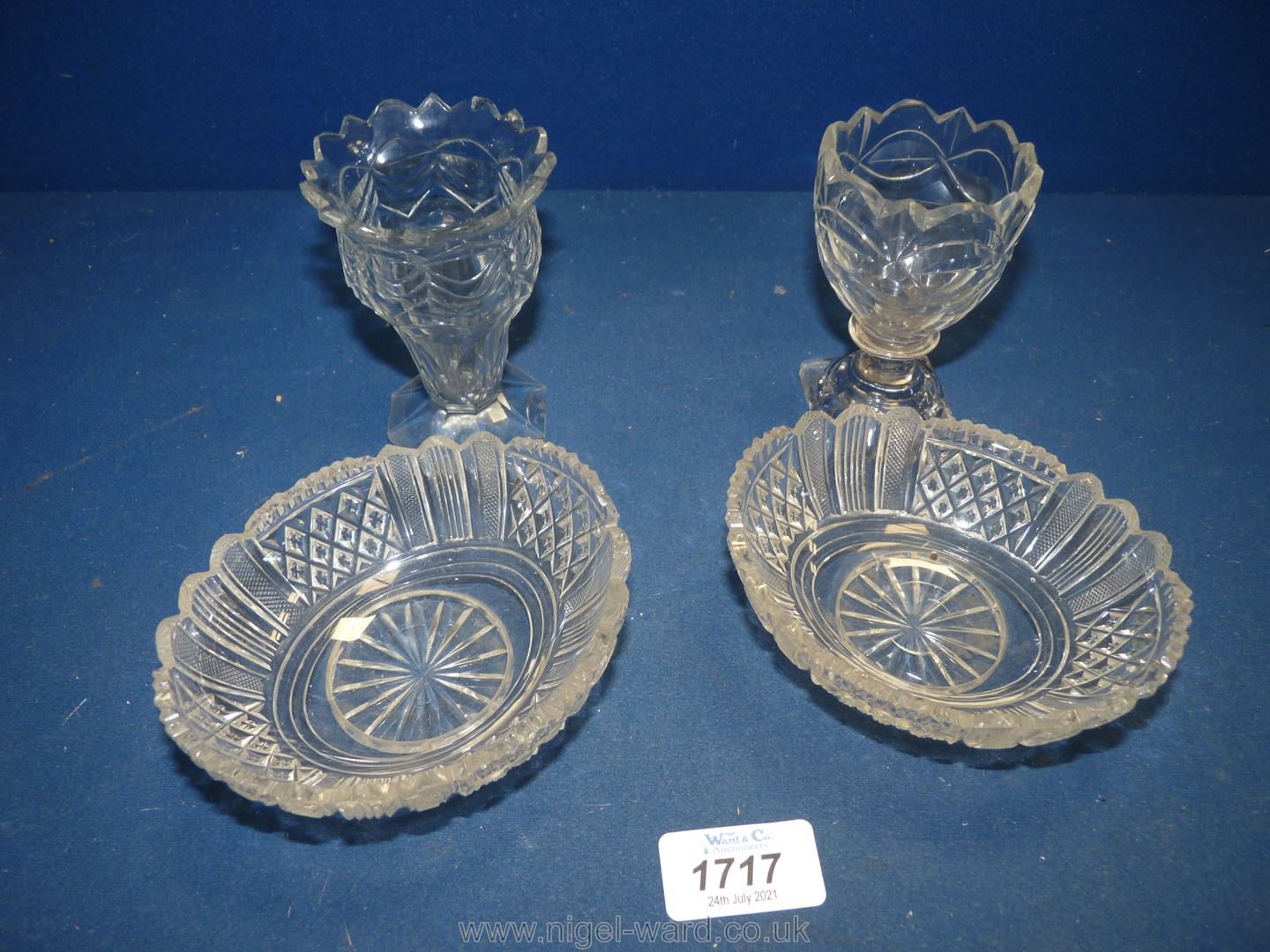 Two fine Regency cut glass dessert dishes and two cut glass posy vases of similar date (both vases