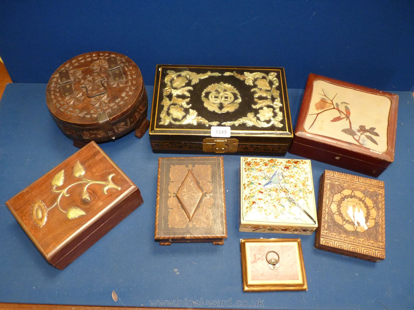 A quantity of oriental boxes including ream with painted detail, brass flower detail,