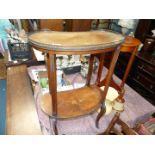 A mixed woods kidney shaped Etagere with ormolu mounts, inlaid detail and pierced brass gallery,