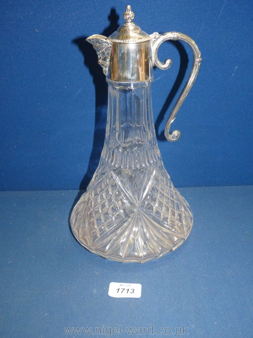 A Claret Jug with plated collar and lid and mask head spout.