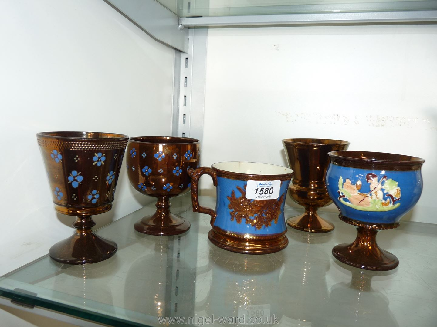 Four lustre Goblets including two with raised blue floral detail, one rural scene and one plain, - Image 2 of 2