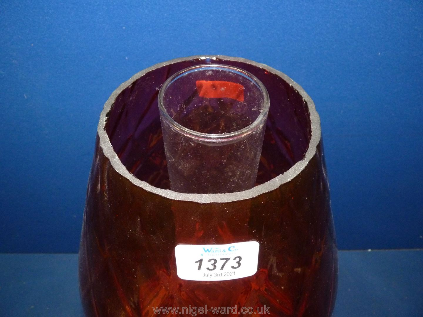A large church oil heater/lamp on brass base with large glass cranberry shade, diamond pattern,
