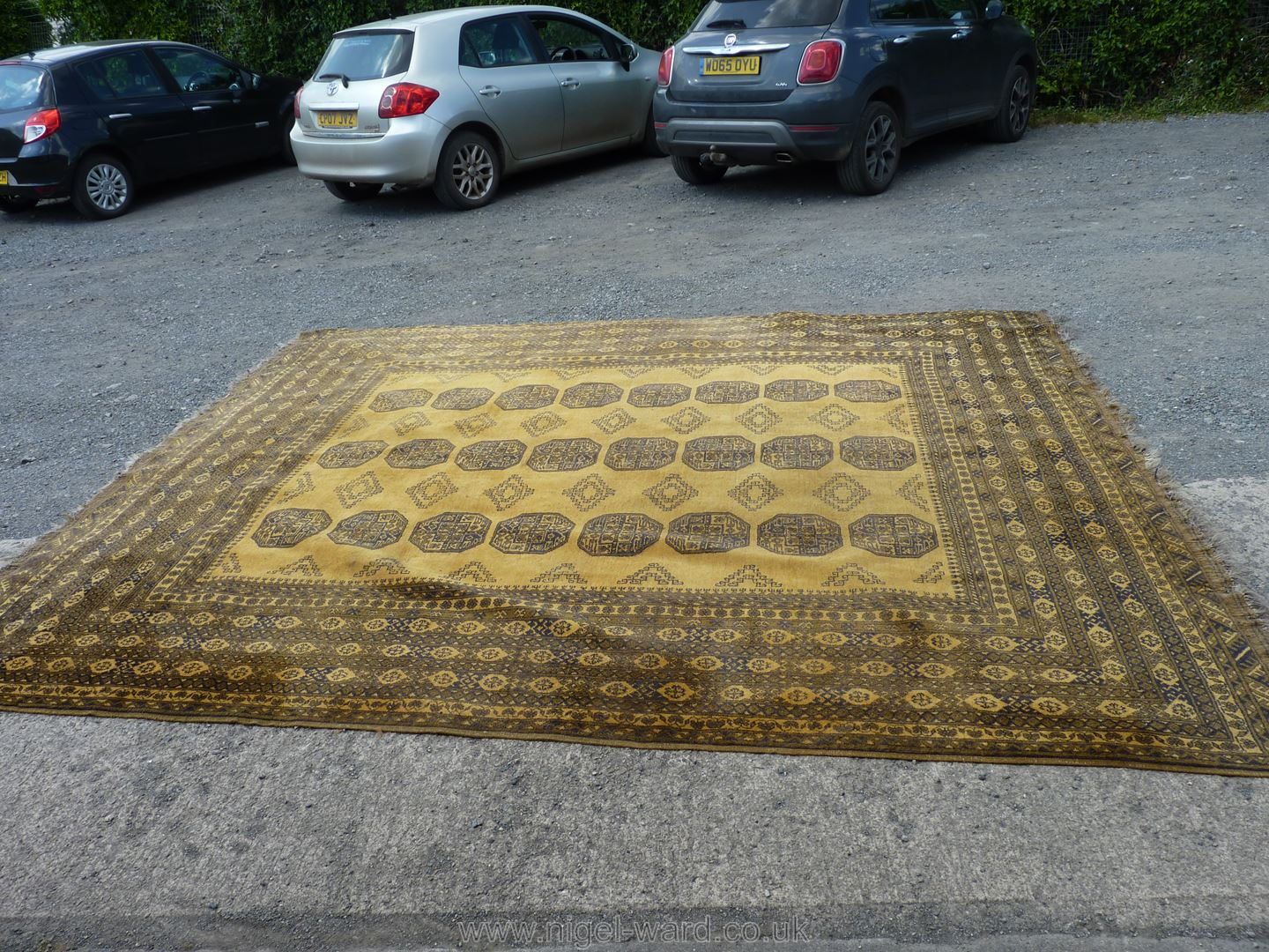 A large bordered, patterned and fringed Rug, gold ground with black geometric pattern, - Image 2 of 3