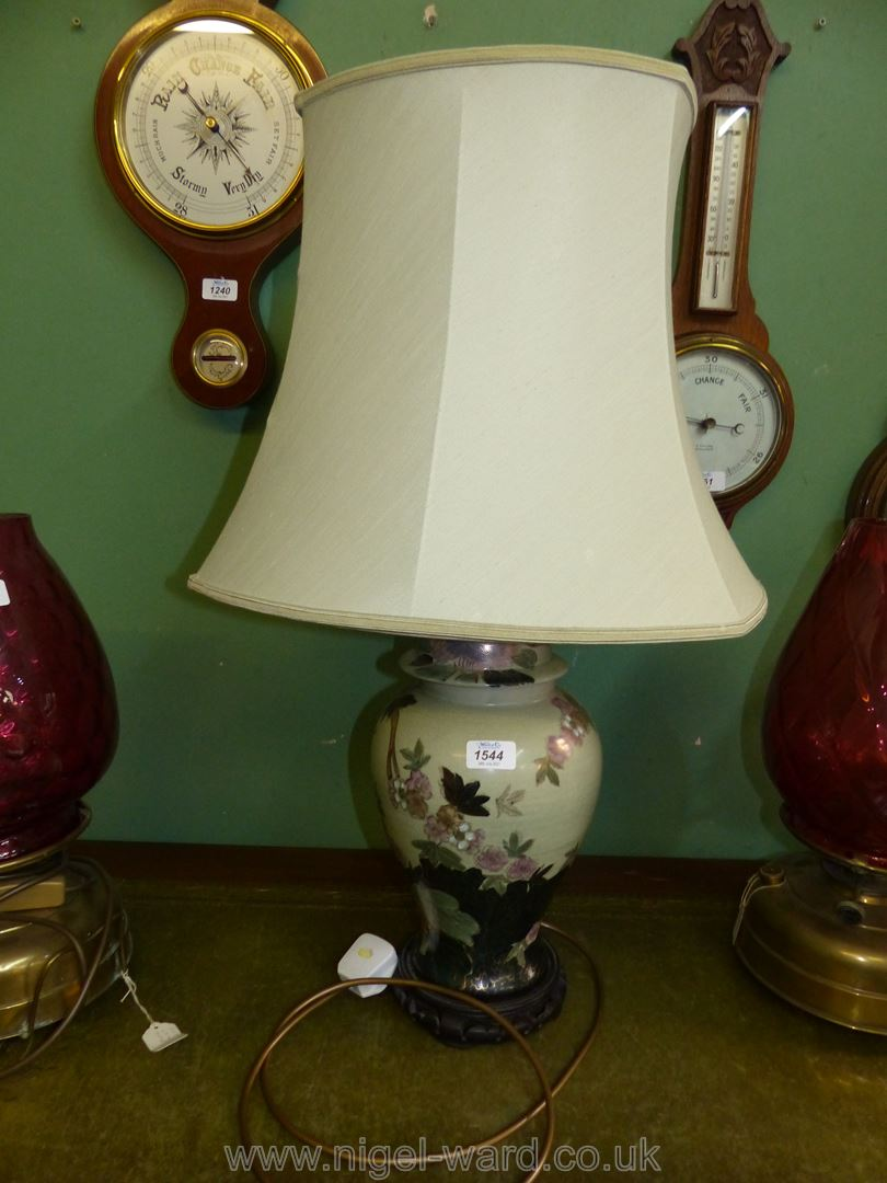 An oriental style table lamp and shade,