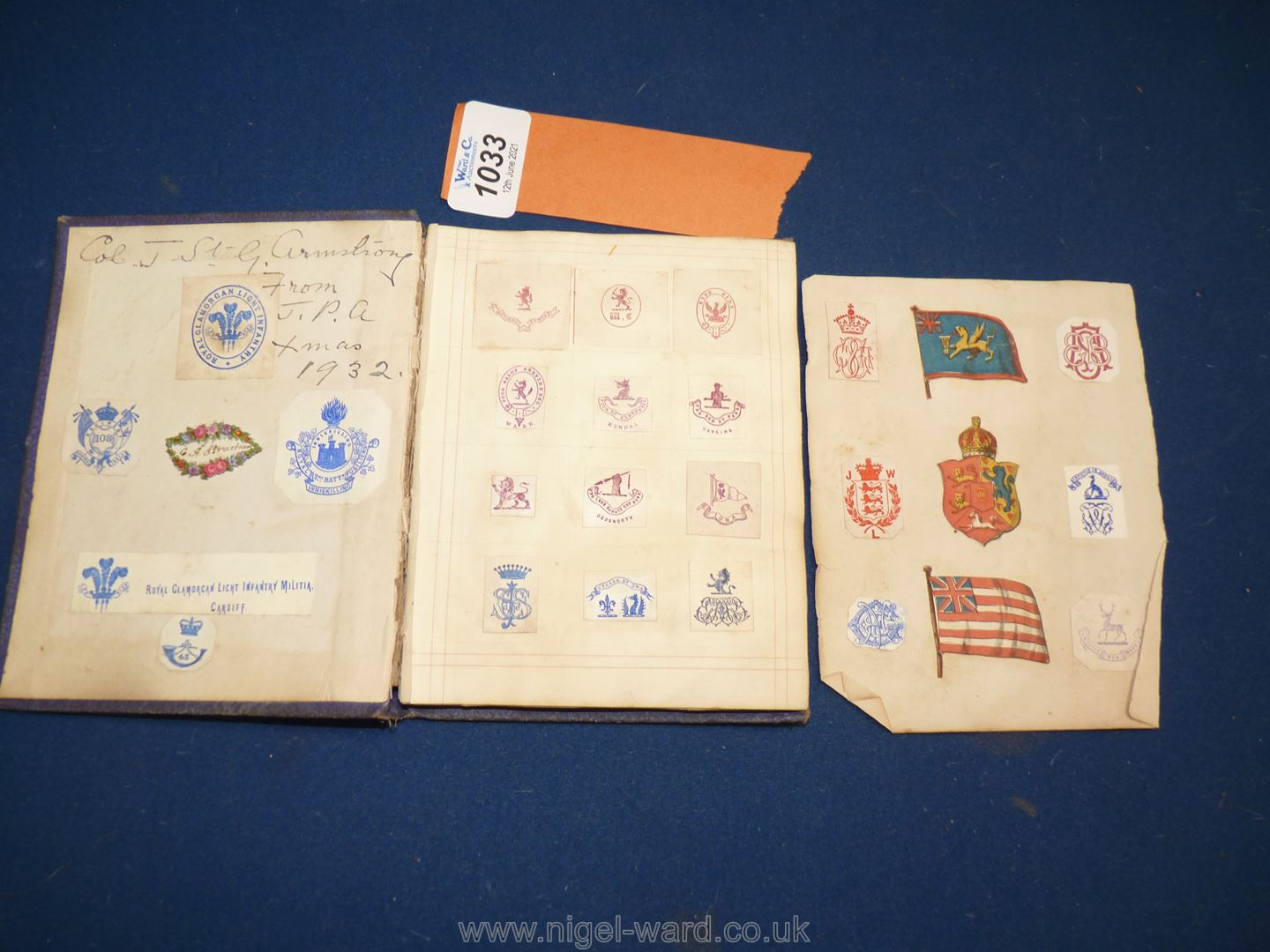 An interesting album of Coats of Arms, ciphers etc including Queen Victoria's family, nobility,