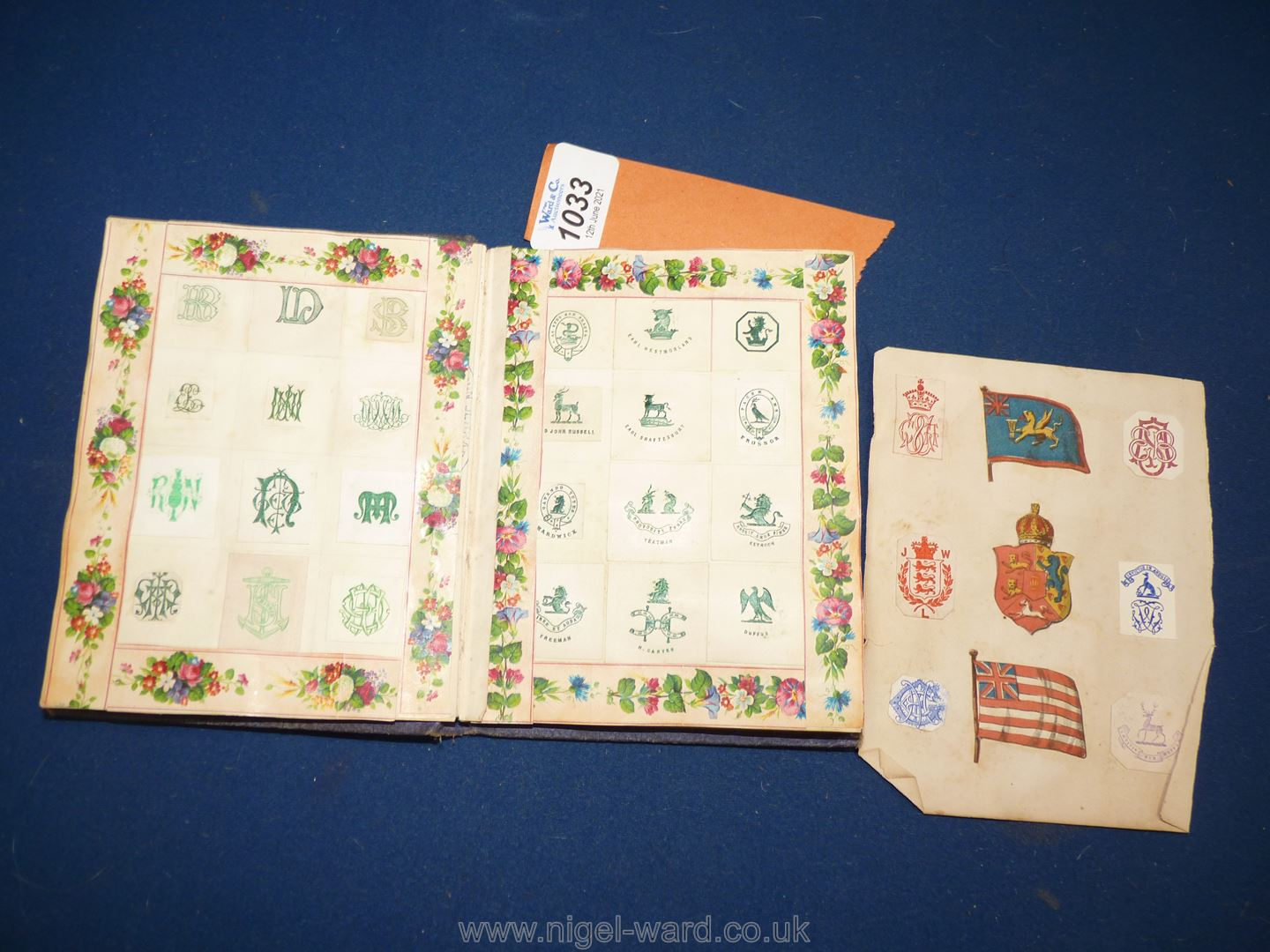 An interesting album of Coats of Arms, ciphers etc including Queen Victoria's family, nobility, - Image 2 of 7