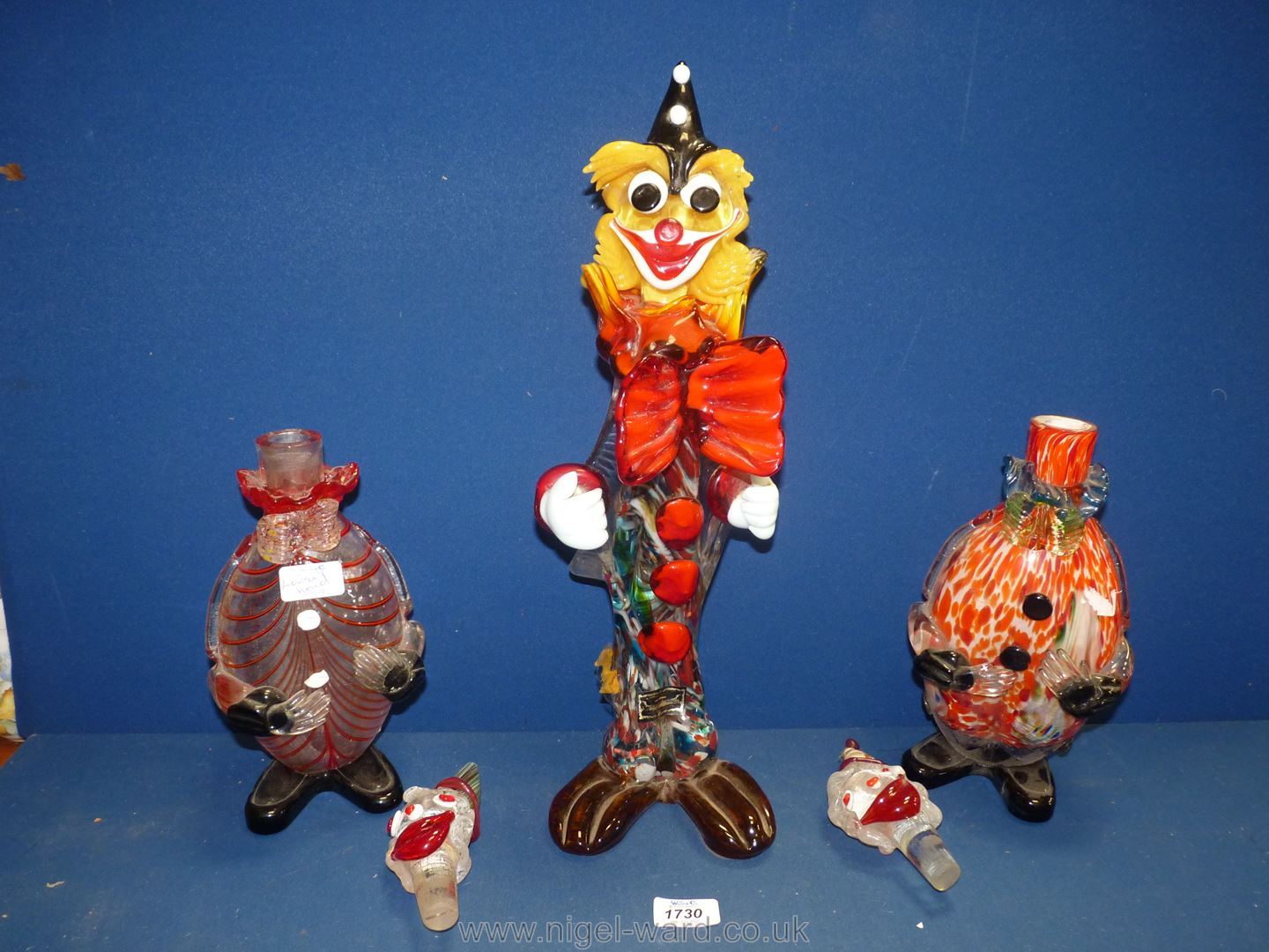 A tall Murano glass Clown, 18 1/2'' and two Clown decanters, 14'' and 14 1/2'' tall.