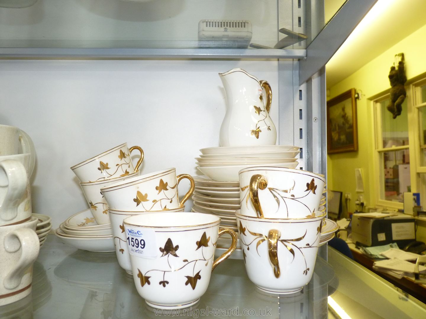 A part Teaset in white and gilt ivy leaf pattern