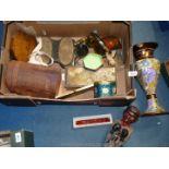 A box of miscellanea including tins, harmonica, etc.