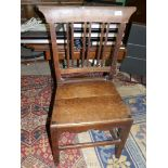 A Georgian oak side chair having solid seat and unusually three double strut back splats.