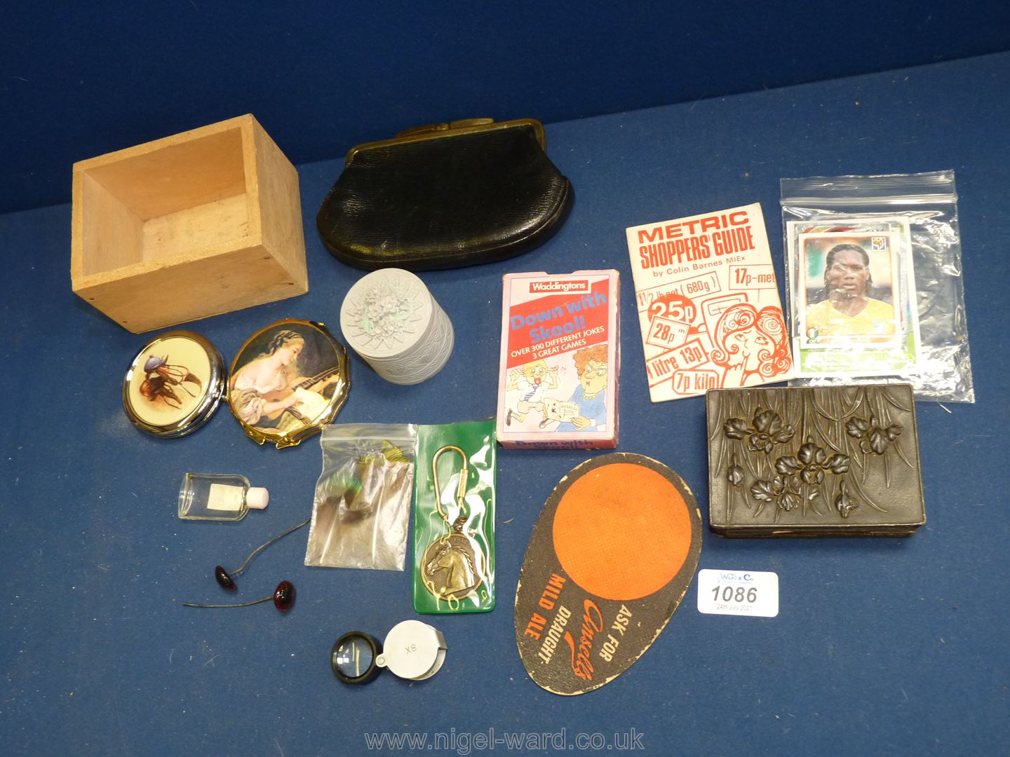 A quantity of miscellanea including compacts, vintage Teddy bear eyes, oriental box etc.