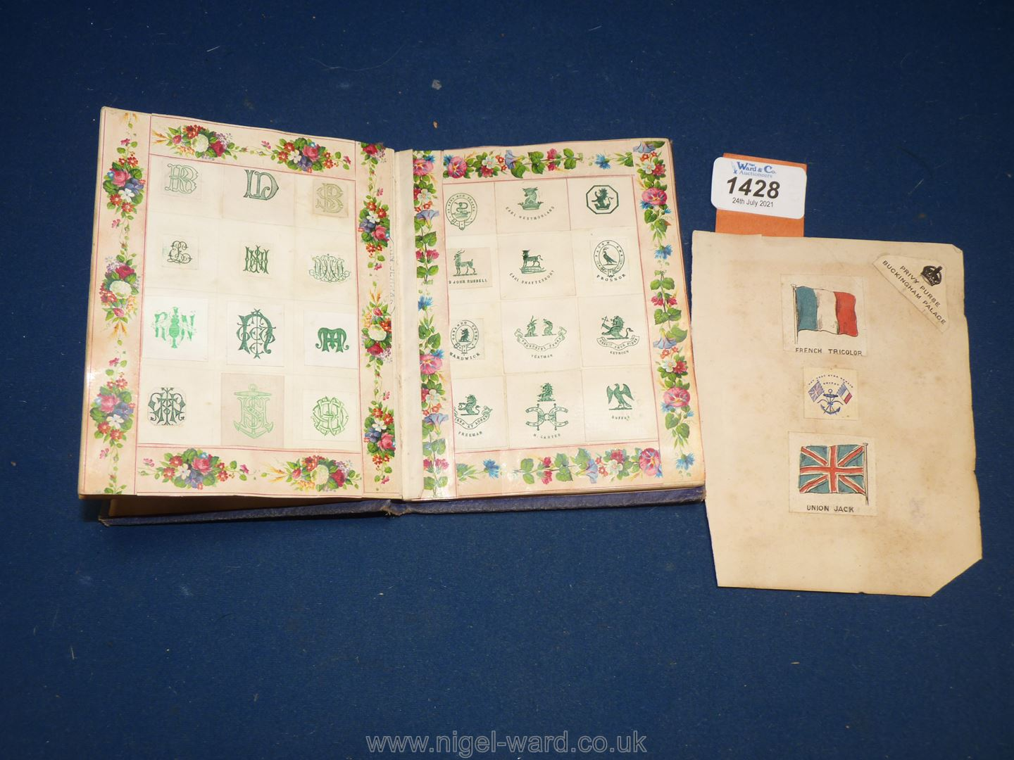 An interesting album of Coats of Arms, ciphers etc including Queen Victoria's family, nobility, - Image 4 of 7