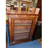 A Victorian Walnut Pier/Side Cabinet having ormolu mounts, crossbanded and inlaid detail,