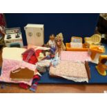 Two Cindy style dolls, clothing and furniture.