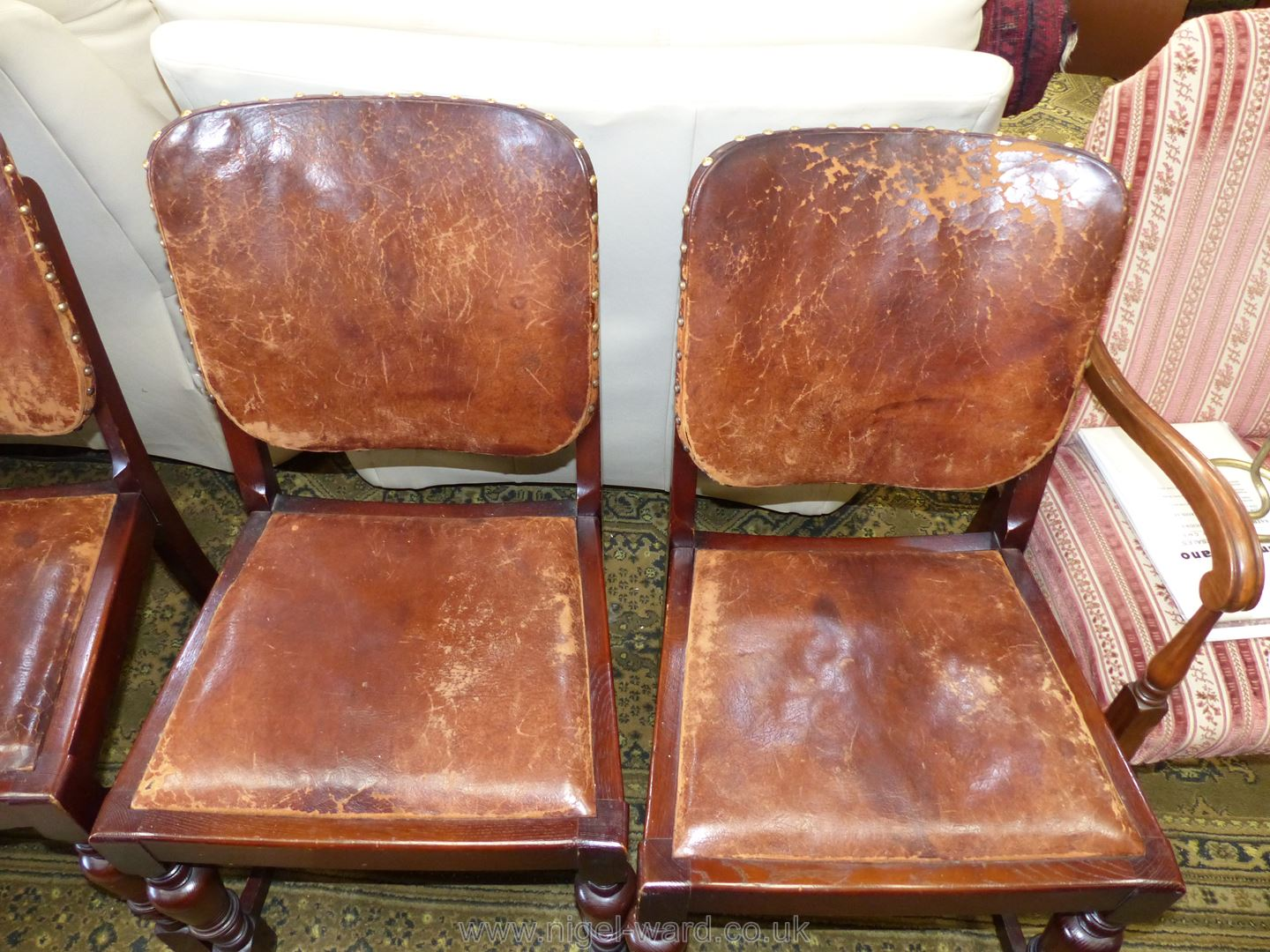 A set of four Oak framed Dining Chairs having brown hide upholstered backs and drop-in seats. - Image 2 of 5