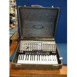 """A Hohner Piano """"Atlantic IV deluxe"""" Accordian, cased."""