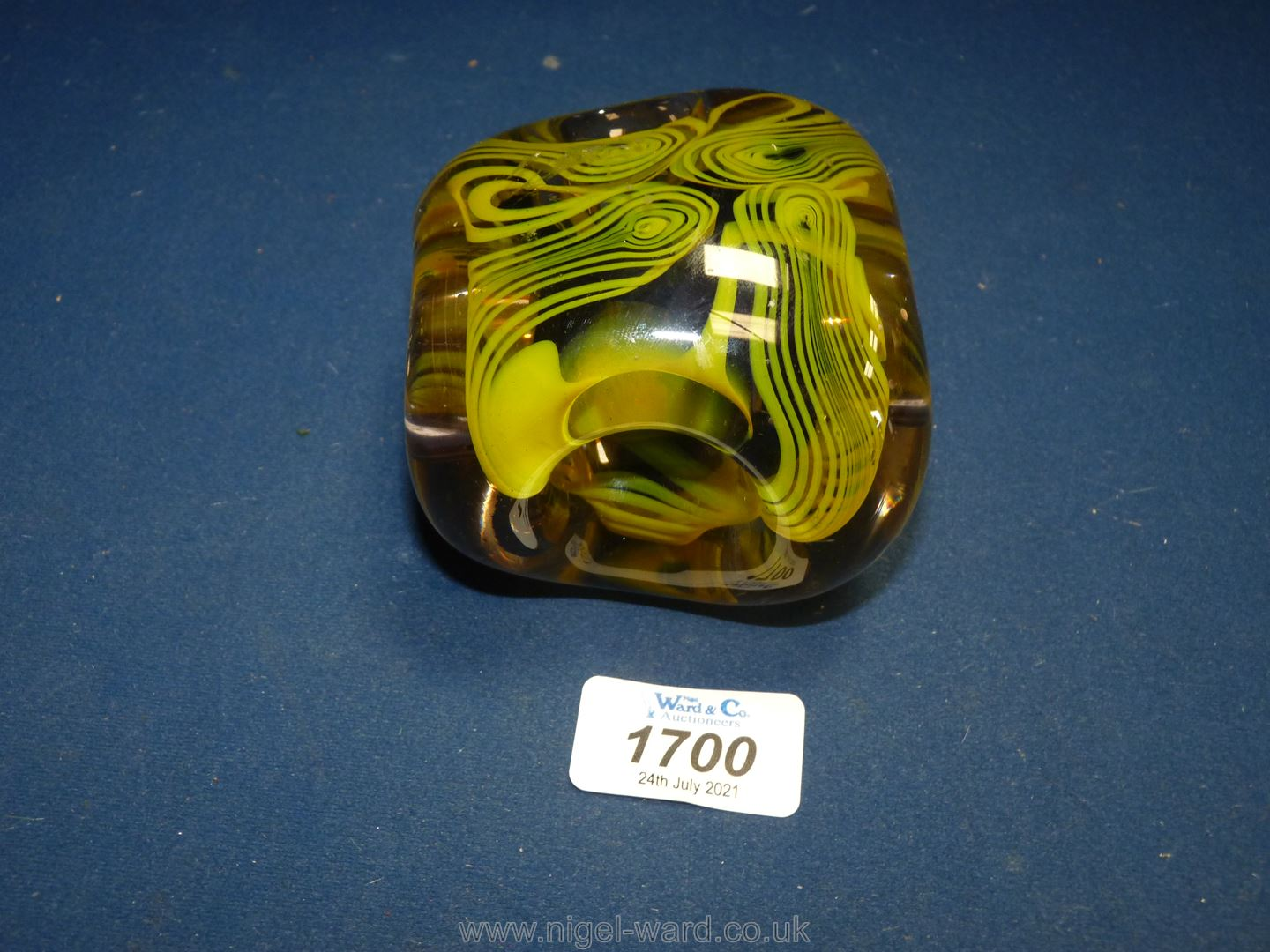 A Karlin Rushbrooke paperweight in yellow and black,