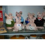 A family of Wade England NatWest pigs plus a second 'Baby' pig.
