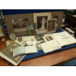 A quantity of black and white photographs and an autograph book.