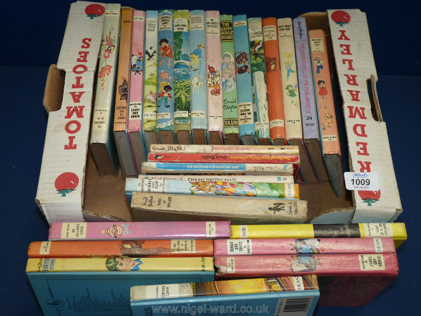 A quantity of Enid Blyton books including 'Bimbo and Topsy' and 'Naughty Amelia Jane'.