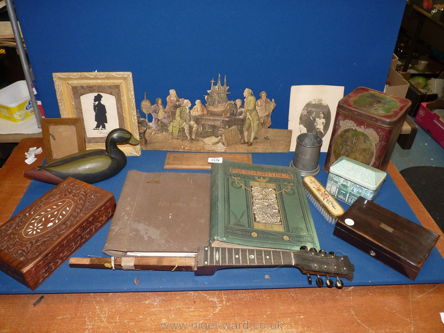 A box of miscellanea including tins, boxes, old documents, original pen and ink cartoon, tankard,