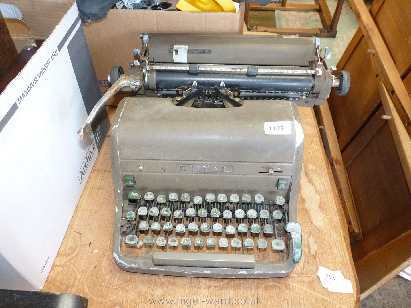 An old Royal typewriter with leatherette cover.