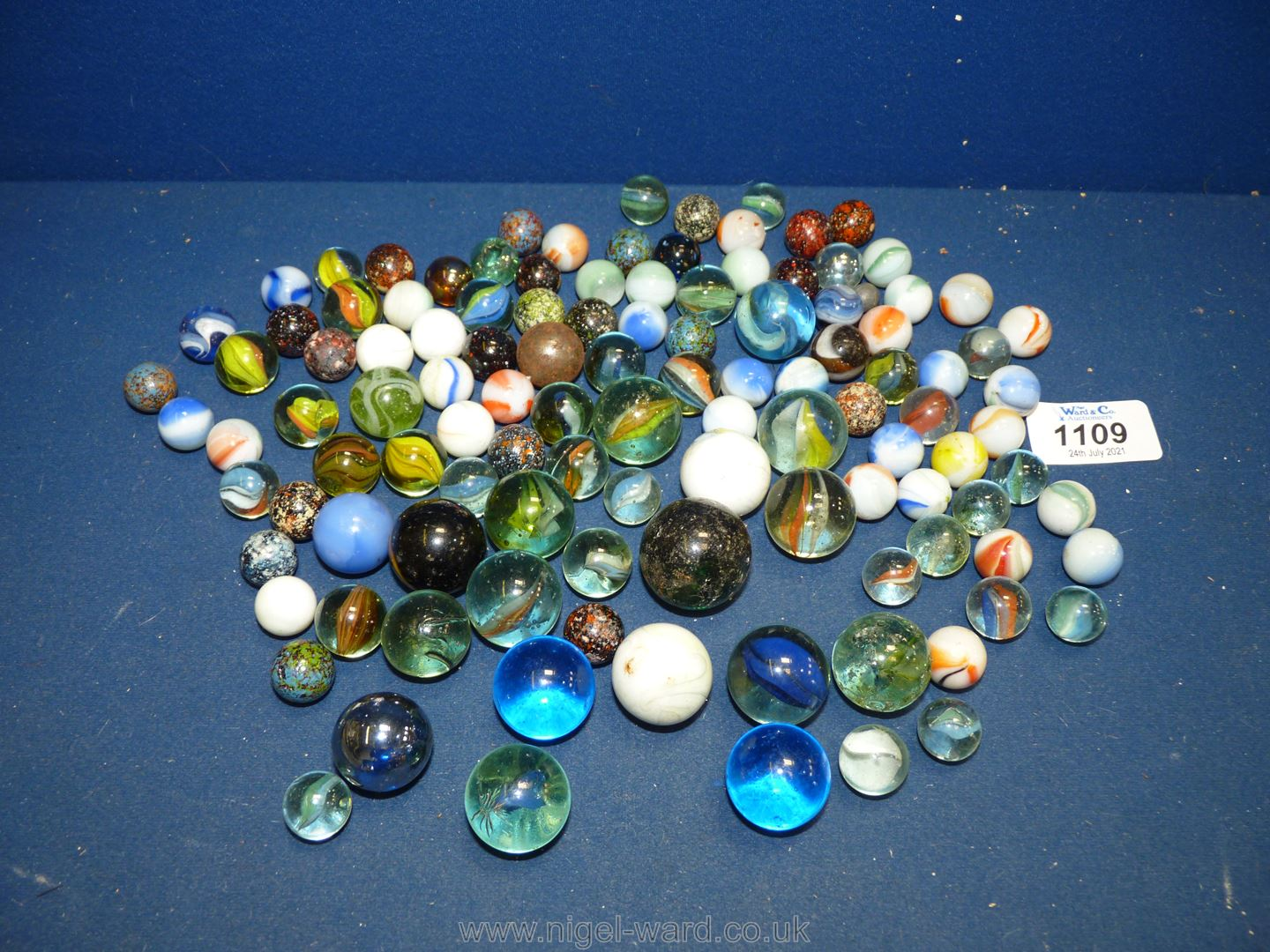 A quantity of marbles including large size, mottled etc.