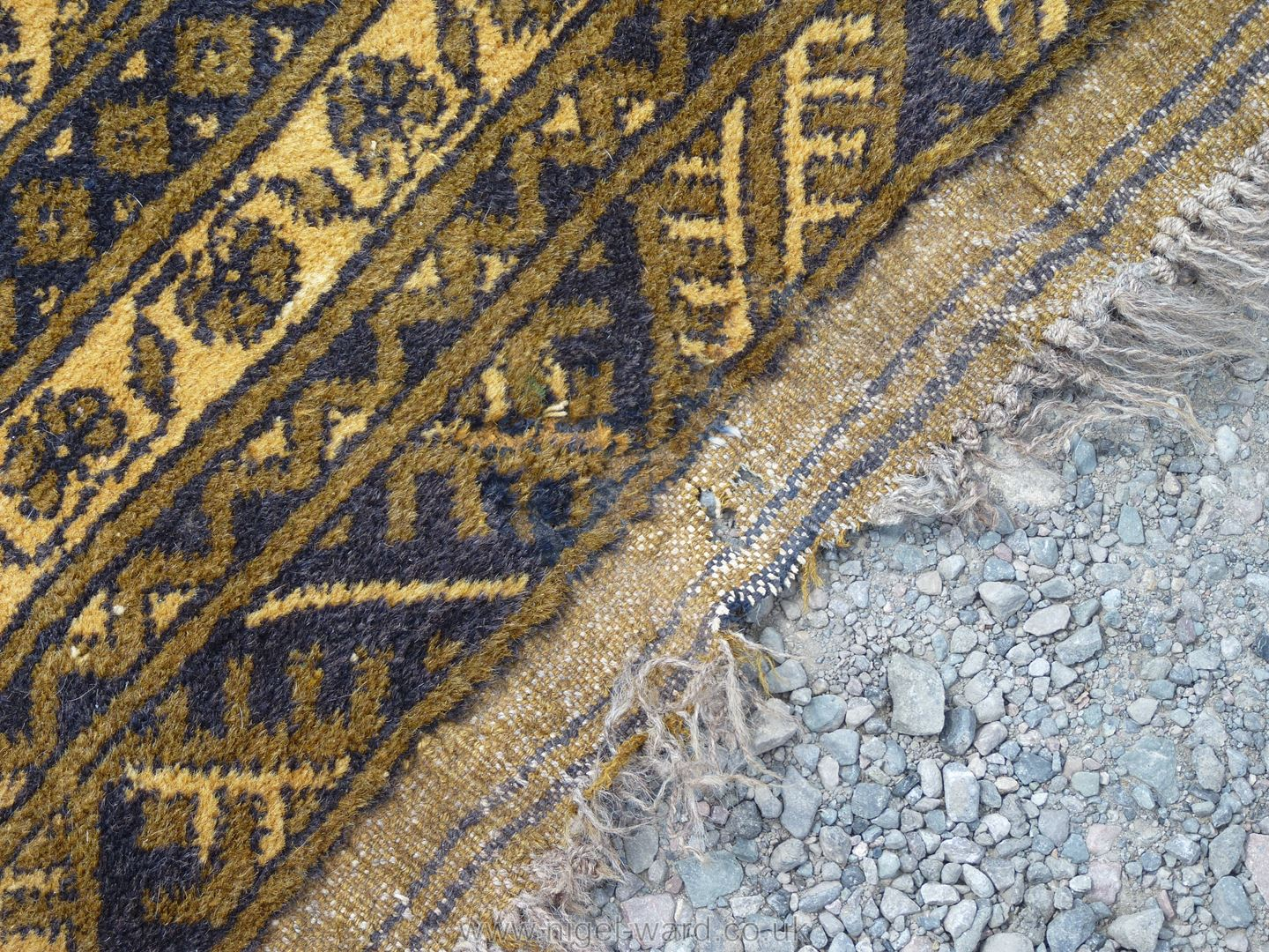 A large bordered, patterned and fringed Rug, gold ground with black geometric pattern, - Image 3 of 3