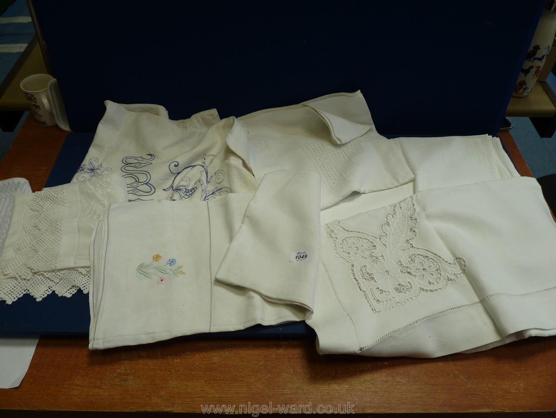 A quantity of Victorian linen items including crochet edged tea tablecloth and linen bag