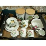 A quantity of Portmeirion Pomona dinner and tableware including two storage jars.