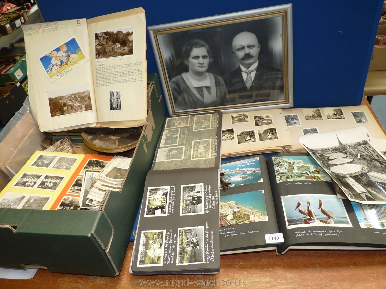 A quantity of framed black and white photographs and albums including weddings, German album etc.