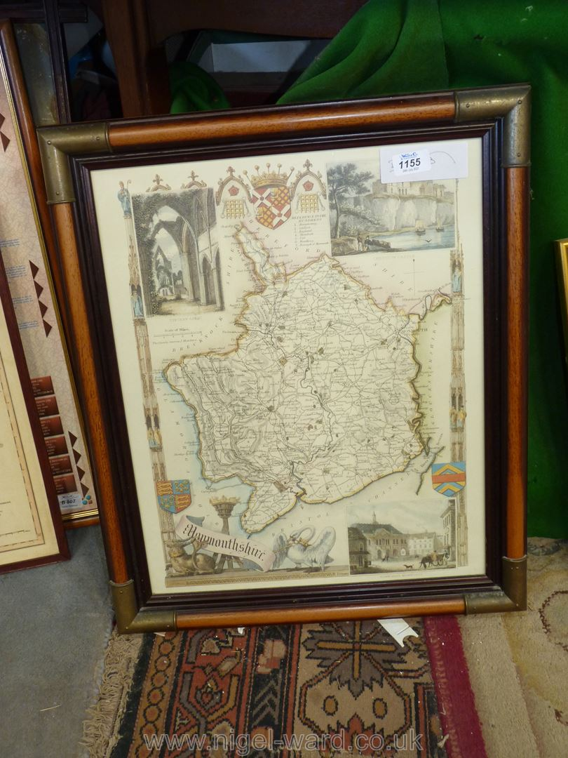 A framed map print of Monmouthshire with three insets of Tintern Abbey, Chepstow Castle etc.